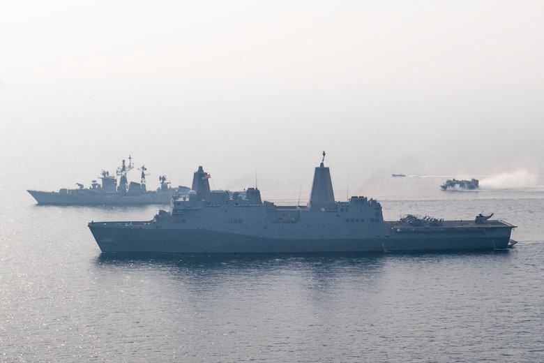 INDIAN OCEAN (Dec. 26, 2018) The San Antonio-class amphibious transport dock ship USS Anchorage (LPD 23), bottom, transits the Bay of Bengal alongside Indian navy destroyer INS Rajput (D 51) while conducting a cooperative deployment with the Indian navy. Anchorage is deployed as part of the Essex Amphibious Ready Group (ARG) and 13th Marine Expeditionary Unit (MEU).
