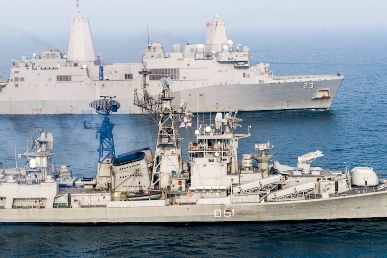 INDIAN OCEAN (Dec. 26, 2018) The San Antonio-class amphibious transport dock ship USS Anchorage (LPD23), top, transits the Bay of Bengal with Indian navy destroyer INS Rajput (D 51) while conducting a cooperative deployment with the Indian navy. Anchorage is deployed as part of the Essex Amphibious Ready Group (ARG) and 13th Marine Expeditionary Unit (MEU).
