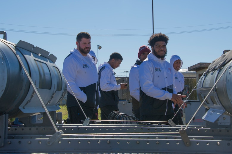 Temple University football players tour a display of munitions used by the B-52 Stratofortress during their visit to Barksdale Air Force Base, Louisiana, December 24, 2018. The team was given a tour of a B-52 in addition to the munitions exhibit during their visit to Barksdale before playing Duke University in the 2018 Walk On's Independence Bowl.(U.S. Air Force photo by Airman 1st Class Maxwell Daigle)