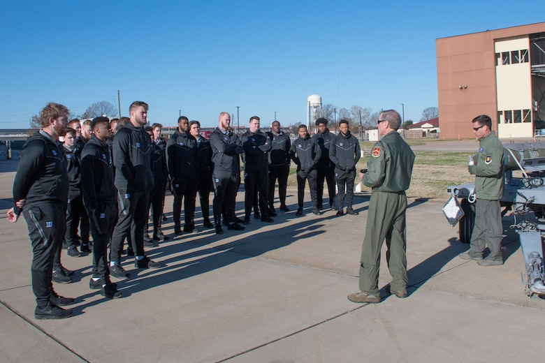 U.S. Air Force Lt. Col.Steven Smith, left, and Lt. Col.Christopher Chandler, both Reserve Citizen Airmen assigned to the 93rd Bomb Squadron, brief Duke University football players during their visit to Barksdale Air Force Base, Louisiana, December 24, 2018. Both the Duke and Temple University football teams visited Barksdale ahead of their matchup in the 2018 Walk On's Independence Bowl. (U.S. Air Force photo by Master Sgt. Ted Daigle)