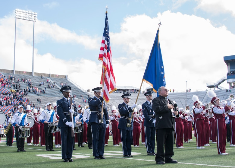 The Barksdale Air Force Base color guard presents the colors during the national anthem ahead of the 2018 Walk On's Independence Bowl in Shreveport, Louisiana, December 27, 2018. Barksdale provided support to the bowl by providing Airmen for the color guard and trophy presentations, as well as giving the participating teams a tour of the B-52 Stratofortress and a munitions display prior to the game. (U.S. Air Force photo by Airman 1st Class Maxwell Daigle)