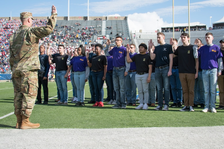 U.S. Air Force Col. Michael Miller, 2nd Bomb Wing commander, administers the oath of enlistment to local recruits during the 2018 Walk On's Independence Bowl in Shreveport, Louisiana, December 27th, 2018. The recruits that took the oath were slated to join various branches and components of the military. (U.S. Air Force photo by Airman 1st Class Maxwell Daigle)