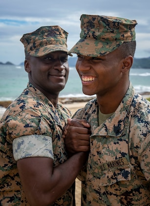 Master Sgt. Ezekiel Kitandwe, the staff noncommissioned officer in charge of Marine Corps Base Hawaii (MCBH) Communication Strategy and Operations, congratulates Sgt. Zachary Orr following his re-enlistment ceremony, MCBH, Nov. 15, 2018. (U.S. Marine Corps photo by Cpl. Luke Kuennen)