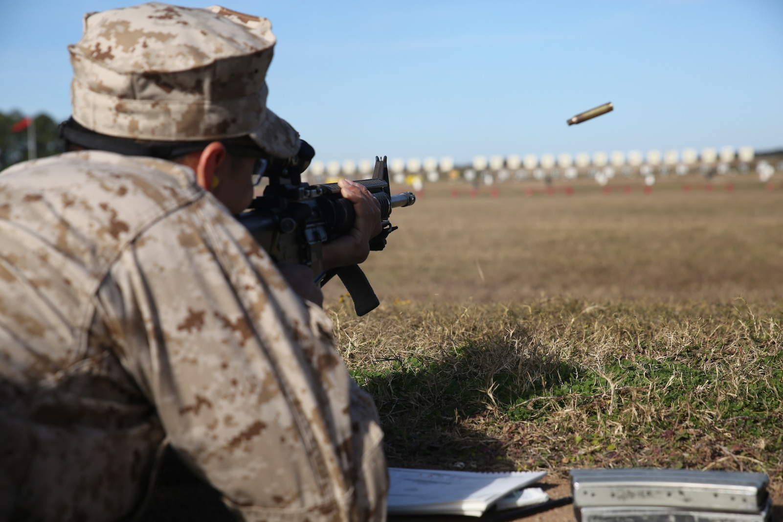 "A recruit with Delta Company, 1st Recruit Training Battalion, fires his M16-A4 service rifle on Marine Corps Recruit Depot Parris Island, S.C, Dec. 26, 2018. Qualifying with the M16-A4 service rifle teaches recruits to understand the weapon system in order to keep with the concept ""Every Marine a Rifleman."" (U.S. Marine Corps photo by Lance Cpl. Shane T. Manson/Released)"