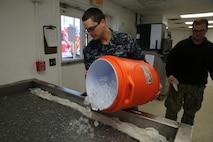 Seaman Joseph T. Frepan prepares an ice tub during the Crucible on Marine Corps Recruit Depot, Parris Island, Dec. 27, 2018.