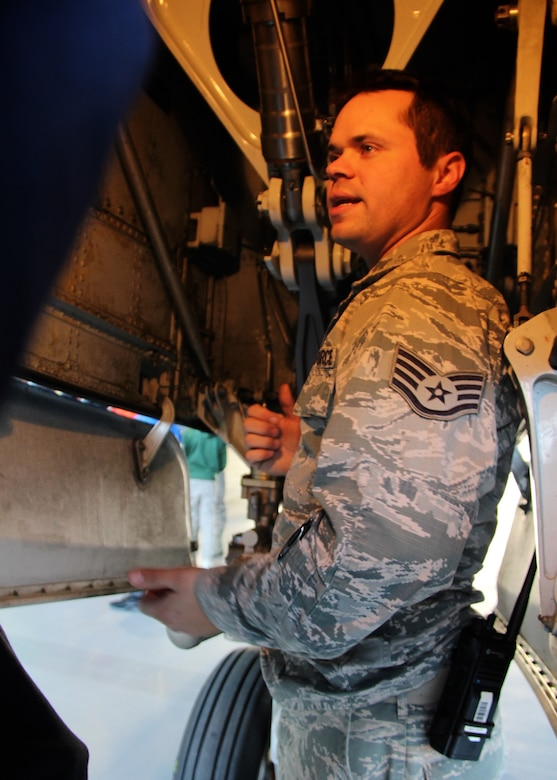 Citizen Airman Staff Sgt. David Schallenberg stands near a C-40 strut as he helps the 932nd Airlift Wing foster goodwill while speaking to eighth grade Science, Technology, Engineering, and Mathematics (STEM) students. They arrived for a visit December 10, 2018, at Scott Air Force Base, Illinois, and Schallenberg, a C-40 aircraft maintainer from the 932nd Maintenance Group, talked to local Mascoutah students about how an airplane engine, wheels, tires, hydraulics, struts and wings work to get a plane off the ground and return safely. He manned an informational station as multiple groups of students rotated through his area every 45 minutes at the Air Force Reserve Command unit in southern Illinois near Belleville. (U.S. Air Force photo by Lt. Col. Stan Paregien)