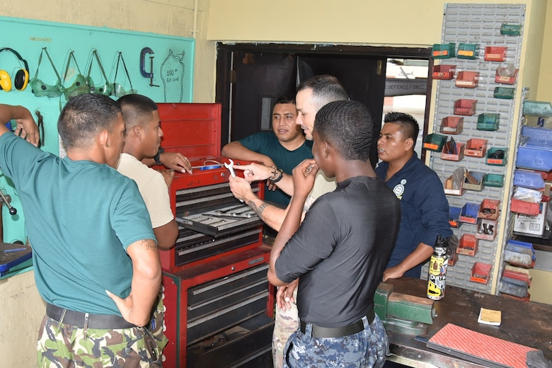 Master Sgt. Raphael Romero, 571st Mobility Support Advisory Squadron aircraft maintenance air advisor, trains members from the Belize Defense Force Air Wing on tool control techniques during a mobile training mission in Ladyville, Belize. (Courtesy Photo)