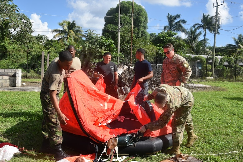 Master Sgt. Natasha Titemore, 571st Mobility Support Advisory Squadron aircrew flight equipment air advisor, trains members from the Belize Defense Force Air Wing on water survival equipment during a mobile training mission in Ladyville, Belize. (Courtesy Photo)