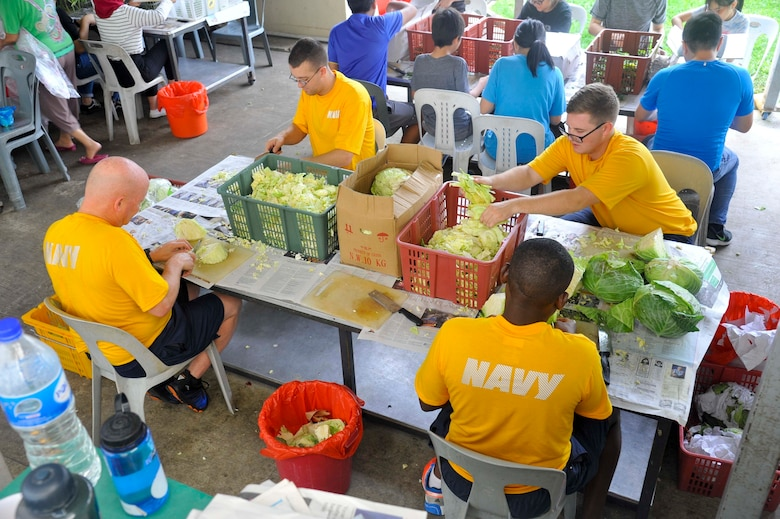SINGAPORE (Dec. 20, 2018) – Sailors assigned to the submarine tender USS Emory S. Land (AS 39) cut cabbage during a community service event at the Willing Hearts Soup Kitchen in Singapore, Dec. 20. Emory S. Land is a forward-deployed expeditionary submarine tender on an extended deployment conducting coordinated tended moorings and afloat maintenance in the U.S. 5th and 7th Fleet areas of operations.