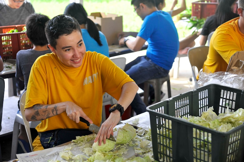 SINGAPORE (Dec. 20, 2018) – Machinery Repairman 3rd Class Alexis Rosales, a Sailor assigned to the submarine tender USS Emory S. Land (AS 39), prepares cabbage during a community service event at the Willing Hearts Soup Kitchen in Singapore, Dec. 20. Emory S. Land is a forward-deployed expeditionary submarine tender on an extended deployment conducting coordinated tended moorings and afloat maintenance in the U.S. 5th and 7th Fleet areas of operations.