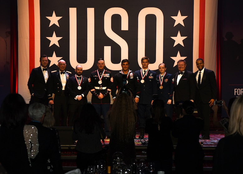 U.S. military members pose for pictures during the 57th Annual USO Armed Forces Gala at the New York Marriott Marquis in New York City, Dec. 12, 2018. Five service members were awarded a medal by the USO for risking their lives to help others in deadly situations. (U.S. Air Force photo by Airman 1st Class Ariel Owings)
