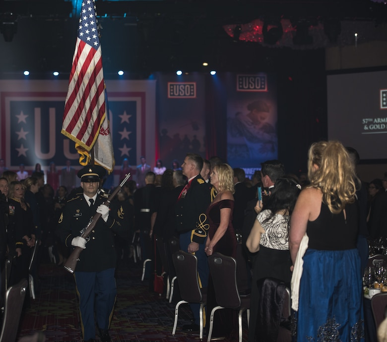 An honor guard, comprised of service members from all branches of the U.S. Armed Forces, walks in formation during the 57th Annual USO Armed Forces Gala at the New York Marriott Marquis in New York City, Dec. 12, 2018. The audience members of the gala stood in respect to honor and support military members and their families. (U.S. Air Force photo by Airman 1st Class Ariel Owings)