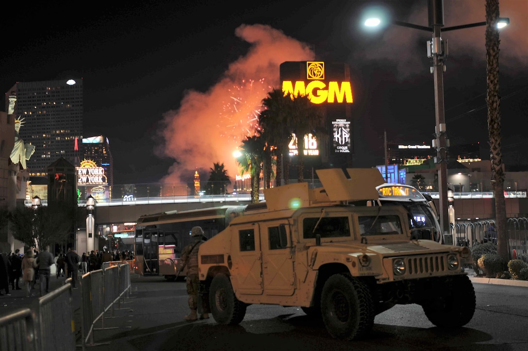 Nevada National Guard Soldiers provide security support to local law enforcement on the Las Vegas Strip as fireworks shoot from the rooftops of hotels during the 2018 New Year's celebration.