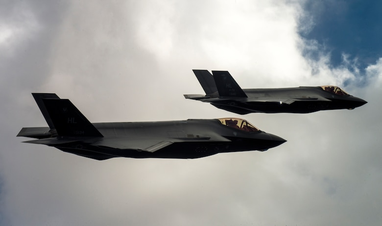 Two U.S. Air Force F-35A Lightning IIs fly over Hill Air Force Base and the surrounding area