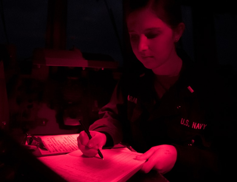 EAST CHINA SEA (Dec. 31, 2018) Ensign Lauren Larar writes the new years deck log entry while underway aboard the Arleigh Burke-class guided-missile destroyer USS McCampbell (DDG 85). McCampbell is forward-deployed to the U.S. 7th Fleet area of operations in support of security and stability in the Indo-Pacific region.