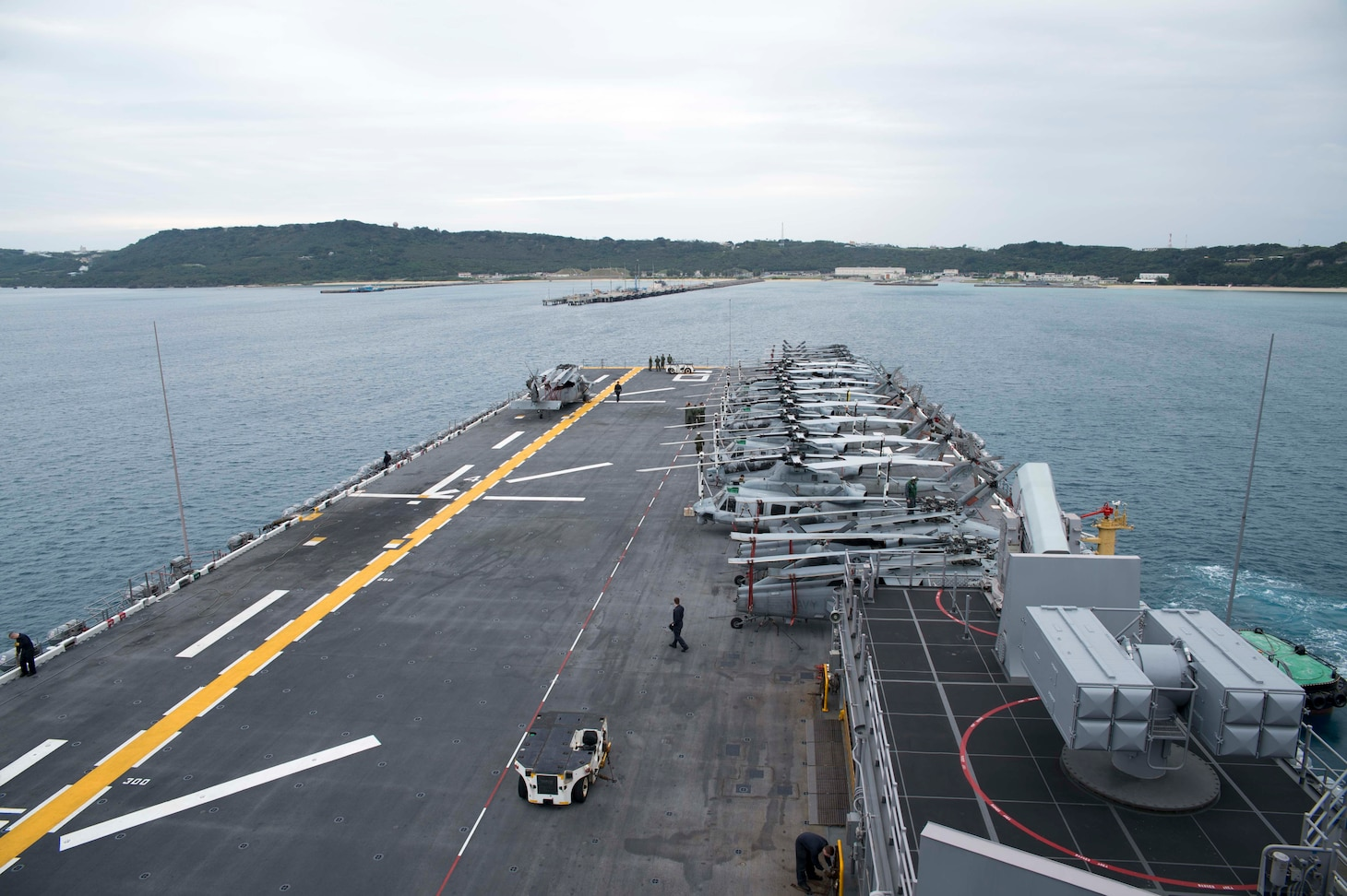 The amphibious assault ship USS Bonhomme Richard (LHD 6) approaches the pier at White Beach Naval Facility. During the visit, the ship will embark 3d Marine Division personnel, vehicles and equipment, prior to continuing a scheduled patrol.