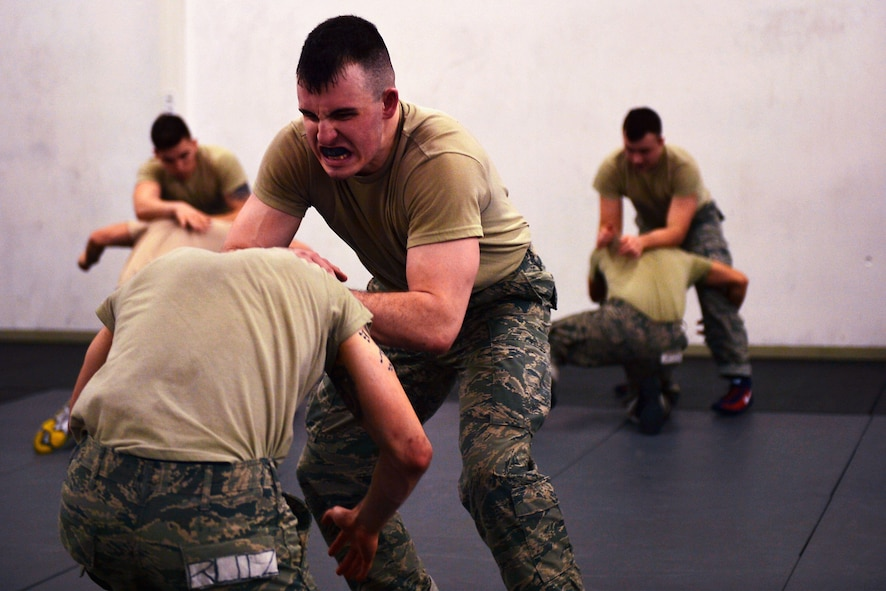 Security Forces Airmen practice combatives during a mobile Phoenix Raven Qualification Course on Ramstein Air Base, Germany, Jan. 29. 2018. Airmen assigned to the 86th and 435th Security Forces Squadrons and the 569th U.S. Forces Police Squadron took part in a course conducted by a mobile training team from Joint Base McGuire-Dix-Lakehurst, New Jersey. (U.S. Air Force photo by Senior Airman Joshua Magbanua)