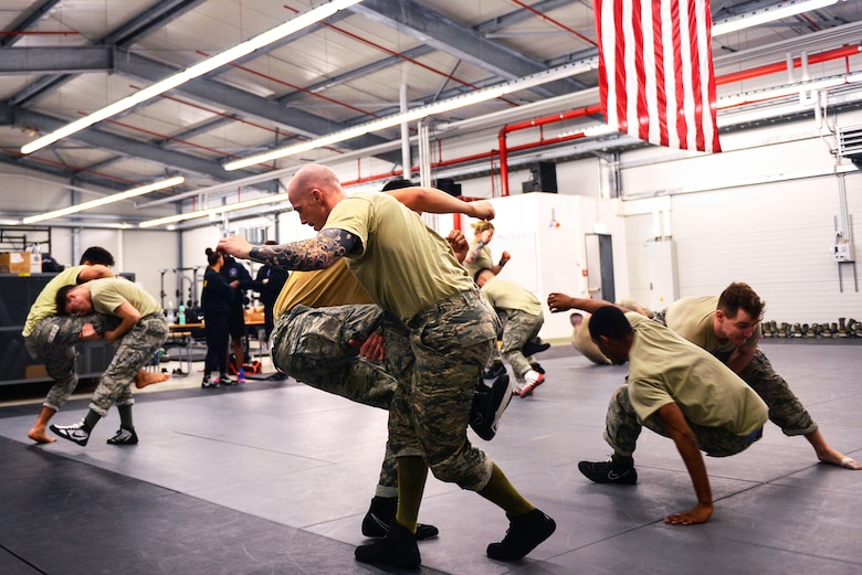 Participants in the Phoenix Raven Qualification Course practice combatives on Ramstein Air Base, Germany, Jan. 29, 2018. Raven instructors assigned to the 421st Combat Training Squadron at Joint Base McGuire-Dix-Lakehurst, New Jersey, formed a mobile training team to conduct the course at Ramstein. (U.S. Air Force photo by Senior Airman Joshua Magbanua)