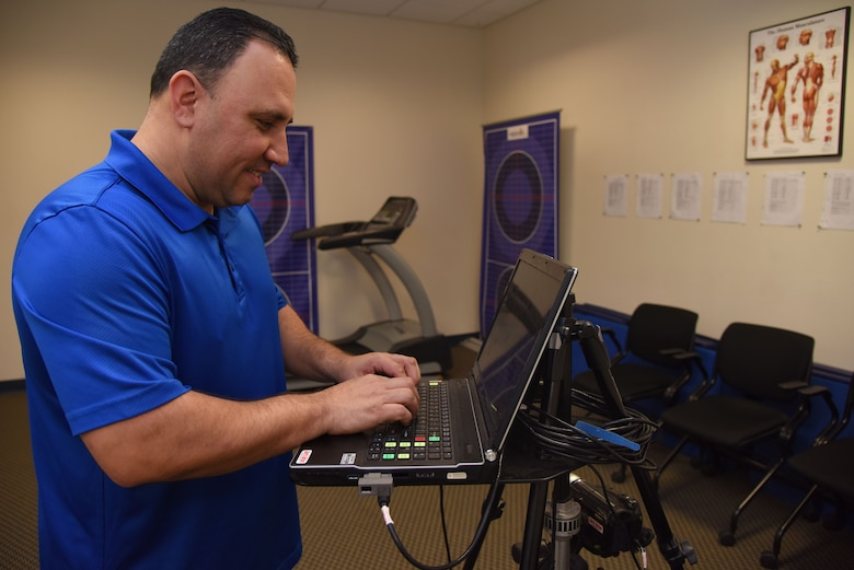 Ray Torres, 47th Medical Operations Squadron health promotion coordinator and exercise physiologist, sets up equipment for a gait analysis at Laughlin Air Force Base, Jan. 31, 2018. A gait analysis is used to measure a patient's body behavior while running in a controlled environment.