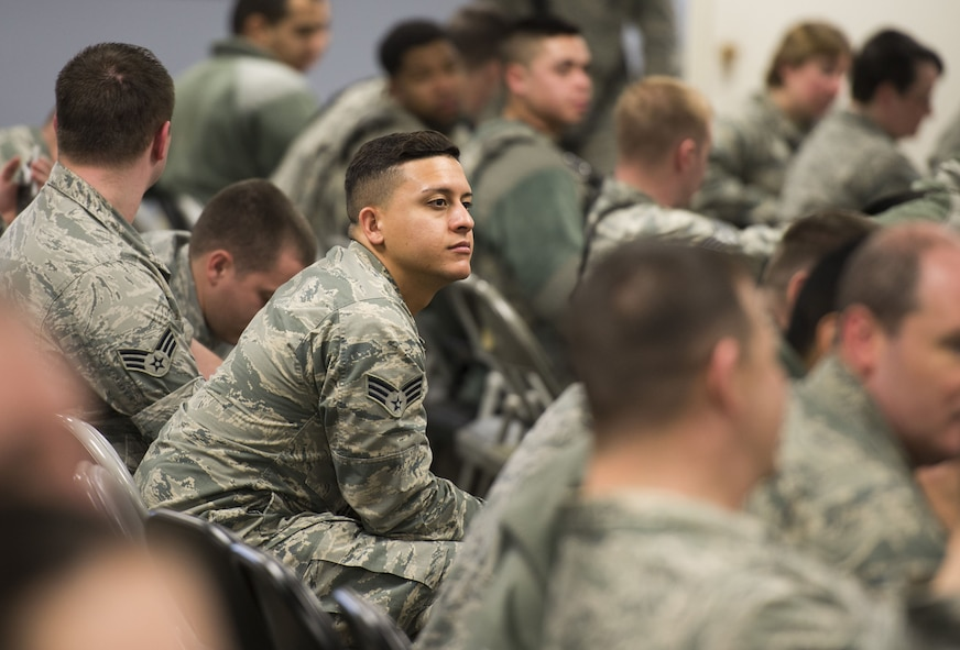 Airman listening to speaker