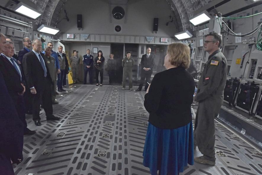 People standing inside a C-17 Globemaster III