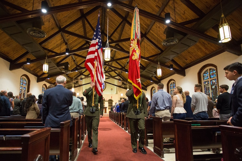 The color guard posts the national and Marine Corps colors during mass for the 75th anniversary of the St. Francis Xavier Catholic Chapel, Jan. 28, on Marine Corps Base Camp Lejeune.