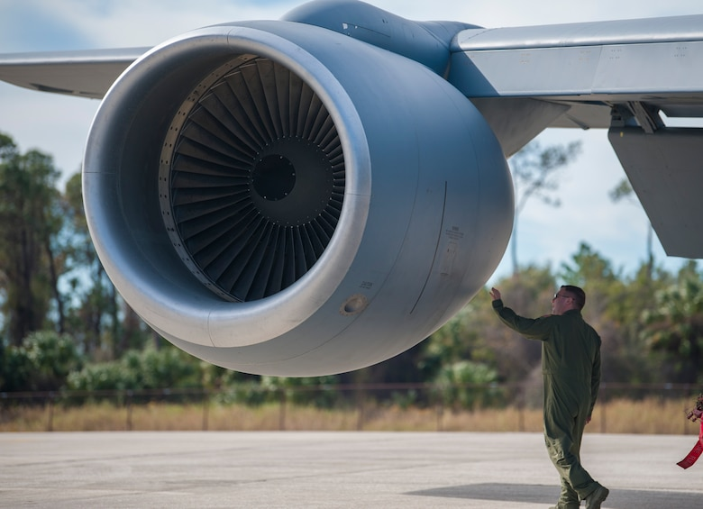 U.S. Air Force Maj. Justin Fadem, director of operations assigned to the 328th Airlift Squadron from Niagara Air Reserve Station (ARS), N.Y., conducts a pre-flight inspection of a KC-135 Stratotanker aircraft at MacDill Air Force Base, Fla., Jan. 30, 2018.
