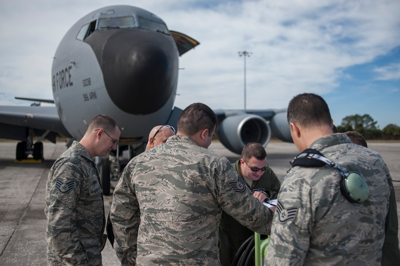 U.S. Air Force Airmen assigned to the 914th Air Refueling Wing (ARW) from Niagara Air Reserve Station, N.Y., review a mission brief prior to a refueling flight at MacDill Air Force Base, Fla., Jan. 30, 2018.