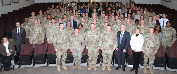Soldiers and civilians pose for a photo before Maj. Gen. Stuart W. Risch, the deputy Judge Advocate General for the U.S. Army, delivers his State of Corps address Jan. 9 at the Donald Evans Auditorium at Joint Base San Antonio-Fort Sam Houston. The purpose of address was to inform the attendees about what to expect during the Article 6 visit.