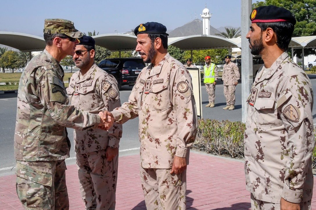 U.S. Army Gen. Joseph L. Votel, commander, U.S. Central Command, shakes hands with officers of the armed forces of the United Arab Emirates (UAE) during exercise Native Fury 18, Jan. 24, 2018. The exercise is designed to train Marines and Sailors in Maritime Prepositioning Force operations and aimed to increase proficiency, expand levels of cooperation, enhance maritime capabilities and promote long-term regional stability and interoperability between the United Arab Emirates and the United States. (U.S. Air Force photo by Tech Sgt. Dana Flamer)