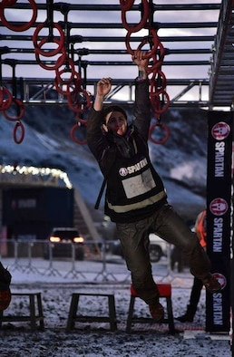 Tech. Sgt. Tania Kennedy, the 270th Engineering and Installation Squadron wire technician, competes in one of the obstacles during the Spartan 2017 Ultra World Championship, Iceland, Dec. 17, 2017. A 111th Attack Wing member, Kennedy only had nine weeks to train for the 24-hour, 30-plus mile ultra competition. (courtesy photo)