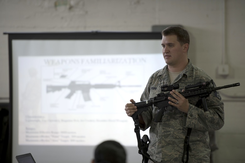 U.S. Air Force Staff Sgt. Charles Pope, a training instructor assigned to the 6th Security Forces Squadron, explains the parts of an M-4 carbine during the integrated base defense portion of Ability to Survive and Operate (ATSO) training at MacDill Air Force Base, Fla., Jan 28, 2018.
