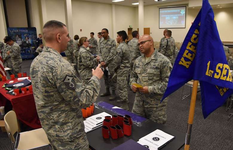Master Sgt. Jason Meuse, 338th Training Squadron first sergeant, briefs Tech. Sgt. Marlon Prevost, 403rd Operations Support Squadron aircrew flight equipment technician, on duties as a first sergeant during the Enlisted Force Career Broadening Fair at the Roberts Consolidated Aircraft Maintenance Facility Jan. 29, 2018, on Keesler Air Force Base, Mississippi. The fair allowed Keesler personnel interested in broadening their career the opportunity to speak with career experts currently serving in a special duty assignment. (U.S. Air Force photo by Kemberly Groue)