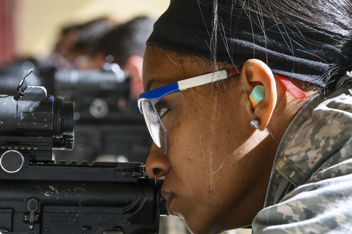 An airman aims at a target during weapons training.