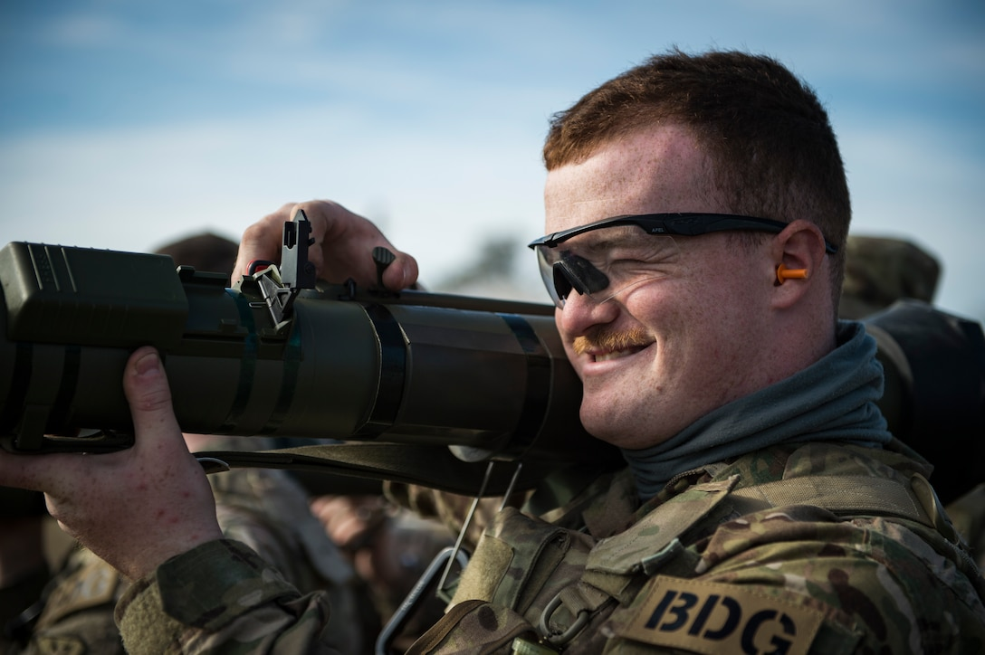 Airman 1st Class Devin Brown, 824th Base Defense Squadron fireteam member, practices the procedures to fire an M136E1 AT4-CS confined space light anti-armor weapon, Jan. 24, 2018, at Camp Blanding Joint Training Center, Fla. The Airmen traveled to Blanding to participate in Weapons Week where they qualified on heavy weapons ranging from the M249 light machine gun to the M18 Claymore mine. (U.S. Air Force photo by Senior Airman Janiqua P. Robinson)