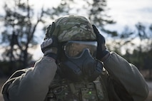 Airman 1st Class Ferriel Burns, 824th Base Defense Squadron fireteam member, adjusts his helmet and gas mask, Jan. 25, 2018, at Camp Blanding Joint Training Center, Fla.The Airmen traveled to Blanding to participate in Weapons Week where they qualified on heavy weapons ranging from the M249 light machine gun to the M18 Claymore mine. (U.S. Air Force photo by Senior Airman Janiqua P. Robinson)