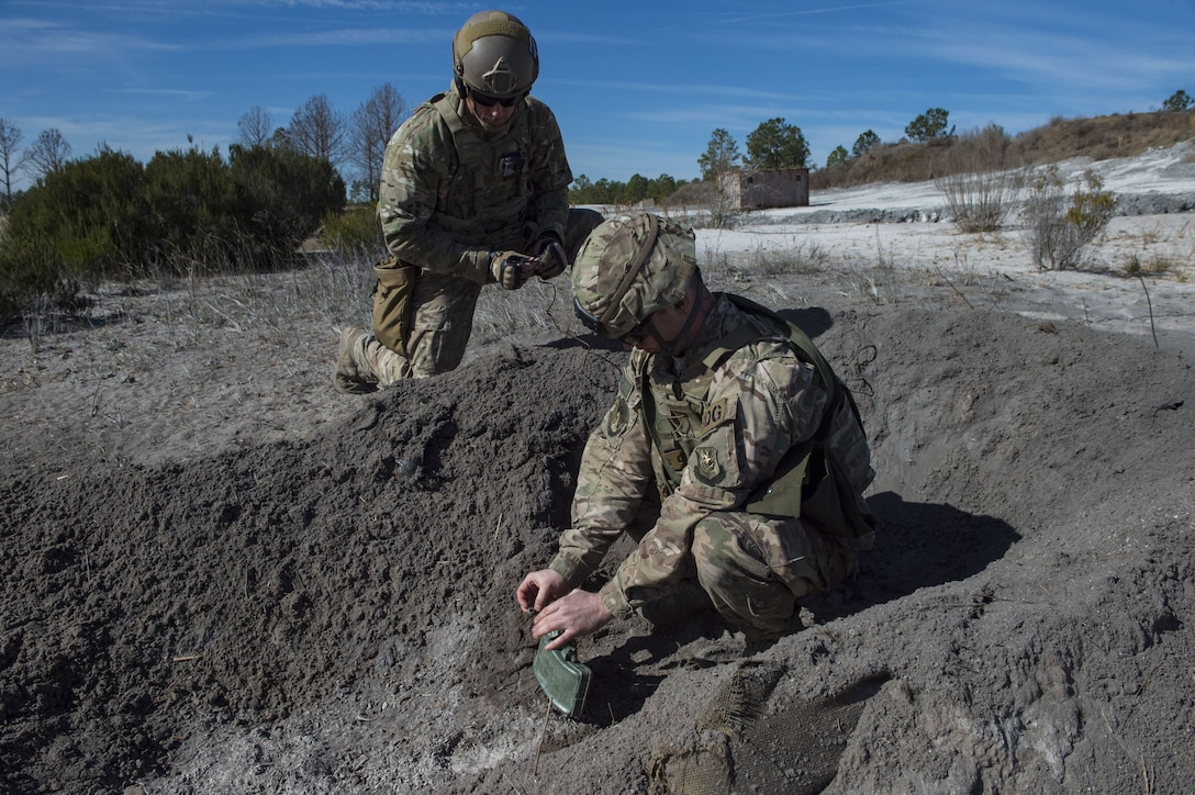 Airmen attach firing wire to an M18 Claymore mine, Jan. 25, 2018, at Camp Blanding Joint Training Center, Fla. The Airmen traveled to Blanding to participate in Weapons Week where they qualified on heavy weapons ranging from the M249 light machine gun to the M18 Claymore mine. (U.S. Air Force photo by Senior Airman Janiqua P. Robinson)