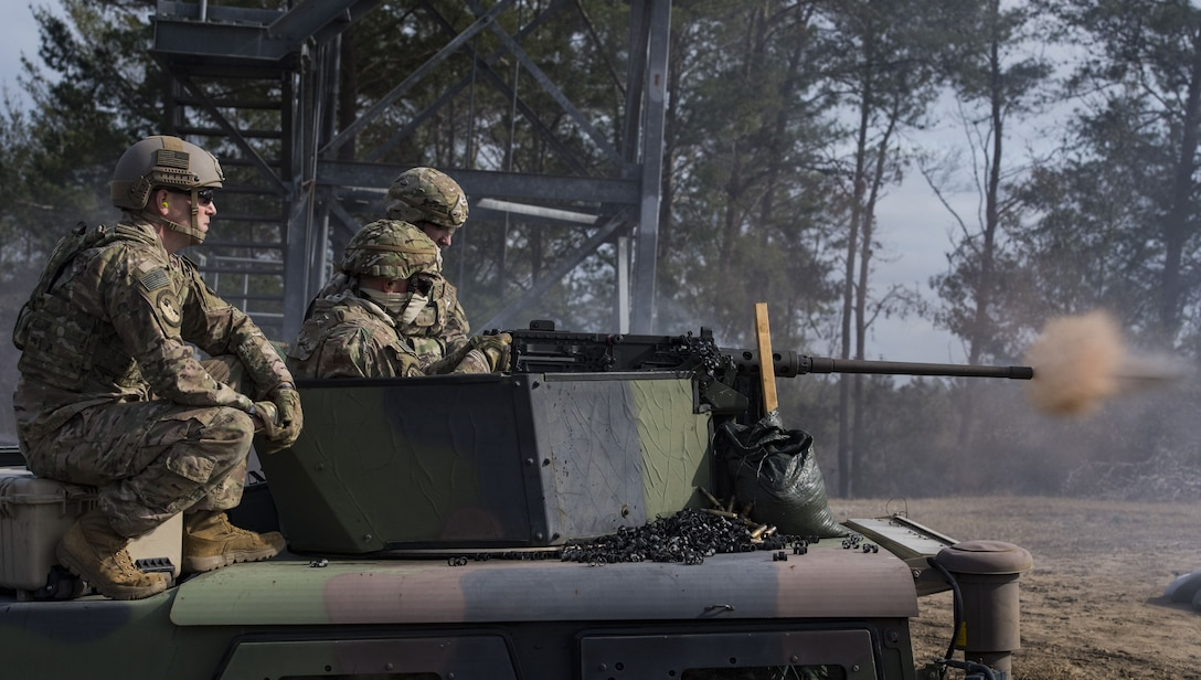 An Airman from the 824th Base Defense Squadron fires an M2 machine gun, Jan. 23, 2018, at Camp Blanding Joint Training Center, Fla.The Airmen traveled to Blanding to participate in Weapons Week where they qualified on heavy weapons ranging from the M249 light machine gun to the M18 Claymore mine. (U.S. Air Force photo by Senior Airman Janiqua P. Robinson)
