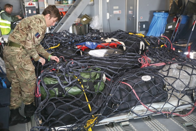 An Airman with the Royal Air Force secures a load of cargo on an A400 Atlas aboard Marine Corps Air Station Beaufort, Jan. 25.