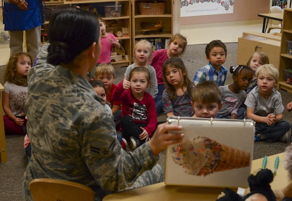 Airman 1st Class Shinique Manders, 23d Areospace Medicine Squadron dental assistant, teaches children which food and drinks are good or bad for their teeth, Feb. 1, 2018, at Moody Air Force Base, Ga. Dental assistants from the 23d Aerospace Medical Squadron visited the Child Development Center as part of National Children's Dental Health Month, to teach children the importance of proper oral care and good habits for taking care of their teeth. (U.S. Air Force photo by Senior Airman Lauren M. Sprunk)