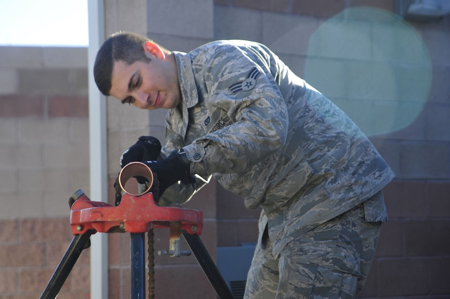 U.S. Air Force Senior Airman Andres Macias, 355th Civil Engineer Squadron HVAC journeyman, reams a copper pipe for a chiller at Davis-Monthan Air Force Base, Ariz., Jan. 31, 2018.