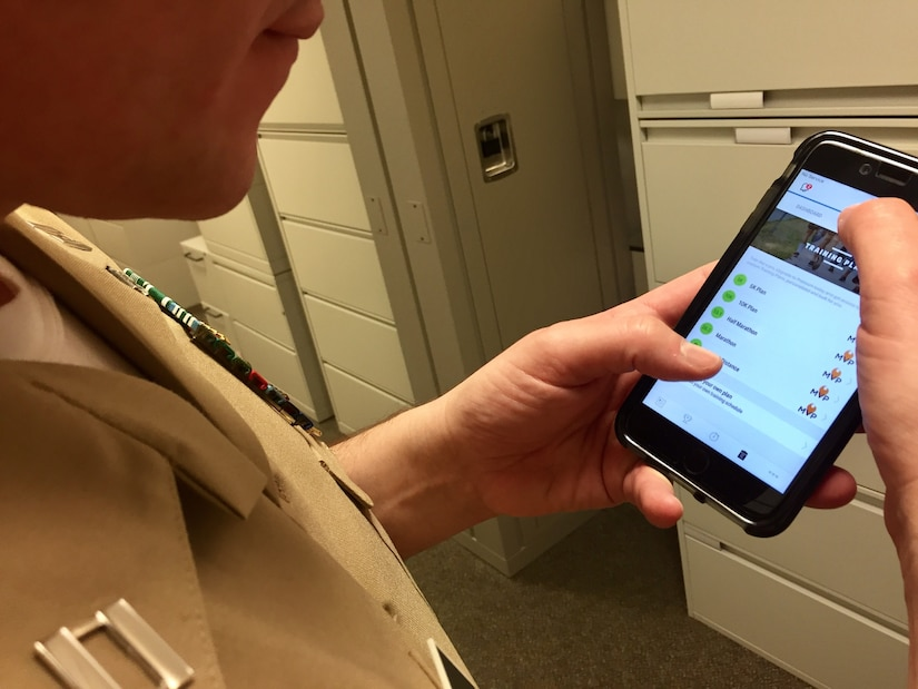 A service member looks at a fitness app on his smartphone at the Pentagon.