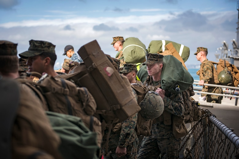 Marines, assigned to the 3d Marine Division (MARDIV), embark the amphibious assault ship USS Bonhomme Richard (LHD 6).