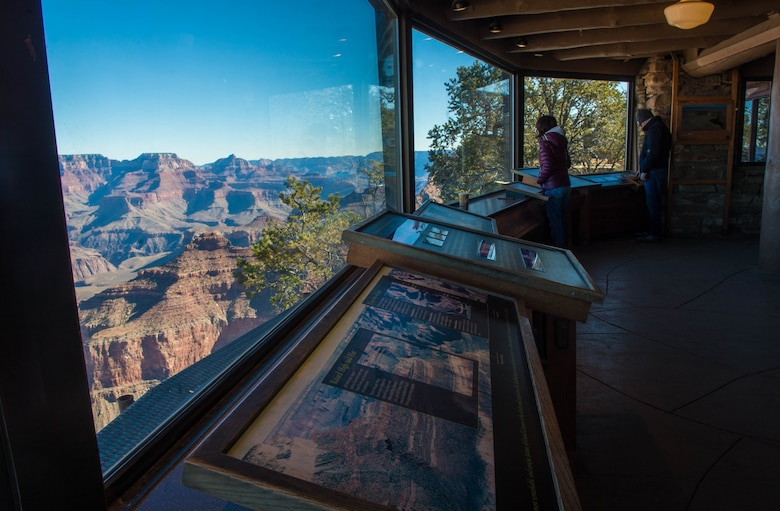 Visitors interact with various maps and documentation in the Yavapi Point Geology Museum in Grand Canyon National Park, Ariz., Jan. 27, 2018. Grand Canyon National Park offers a multitude of educational and historical opportunities for Airmen stationed at Luke Air Force Base to learn about southwest heritage and culture. (U.S. Air Force photo/Airman 1st Class Caleb Worpel)