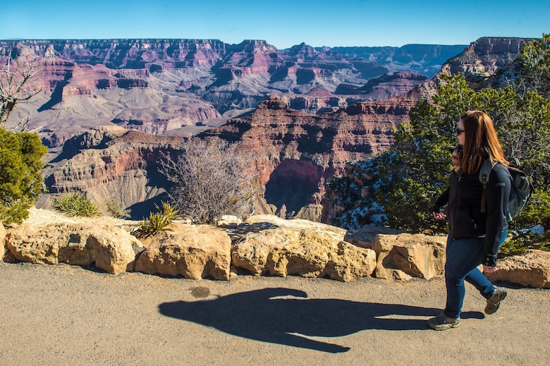 A visitor walks along the south rim of the Grand Canyon in Grand Canyon National Park, Ariz., Jan. 27, 2018. The park is a popular destination for Airmen assigned to Luke Air Force Base offering scenic views, hiking trails and much more. (U.S. Air Force photo/Airman 1st Class Caleb Worpel)