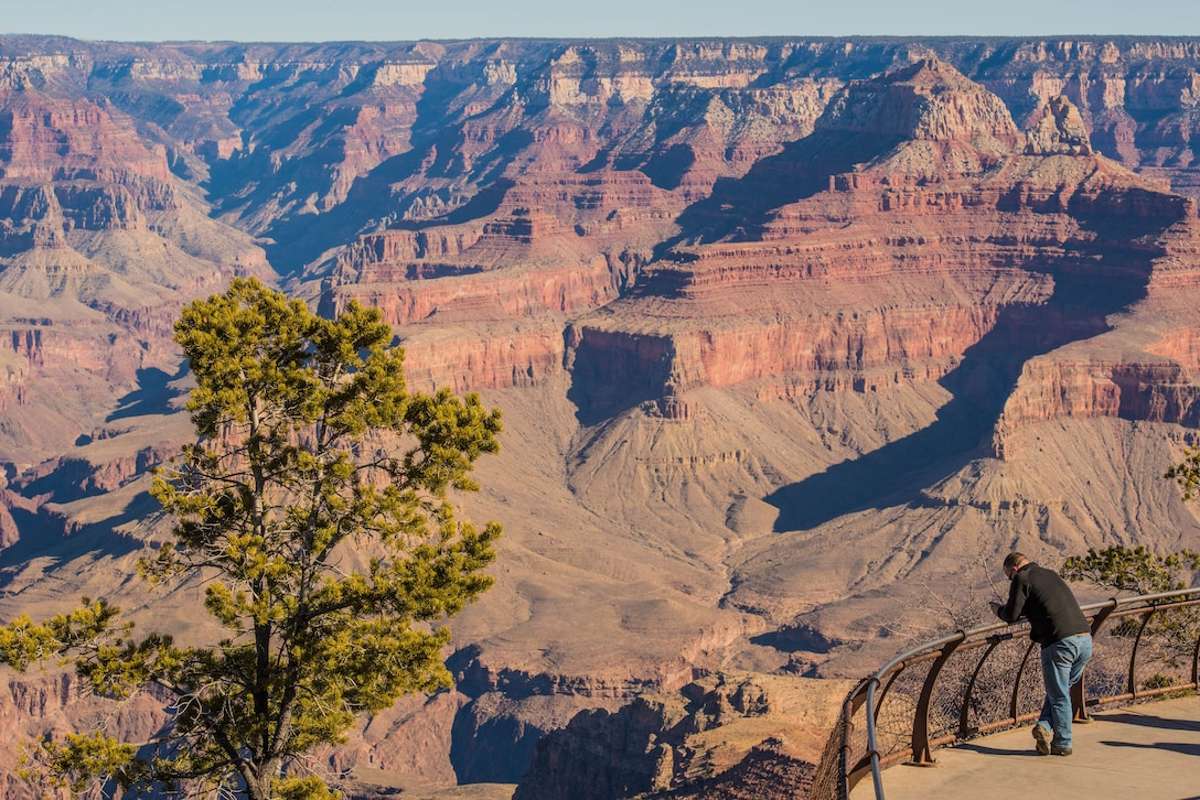 A visitor views the Grand Canyon from Mather Point in Grand Canyon National Park, Ariz., Jan. 27, 2018. For Airmen stationed at Luke Air Force Base, the Grand Canyon is one of the most popular destinations which they can visit while stationed in Arizona. (U.S. Air Force photo/Airman 1st Class Caleb Worpel)