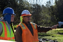 Quality Assurance Specialist Mary DeVries discusses debris removal operations in Napa County, CA, with USACE Quality Assurance Supervisor Richard Aguirre. Members from the Bureau of Reclamation are augmenting the USACE quality assurance mission during recovery from devastating wildfires which began in October 2017.