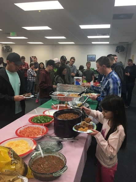 Airmen from the First Term Airmen's Center and their families enjoy a home-cooked meal with Hill Air Force Base leaders at the Junior Enlisted Recreation Center Jan. 31, 2018. The dinners provides first-term Airmen and their families an opportunity to mingle with leadership and make valuable contacts. (Courtesy photo)