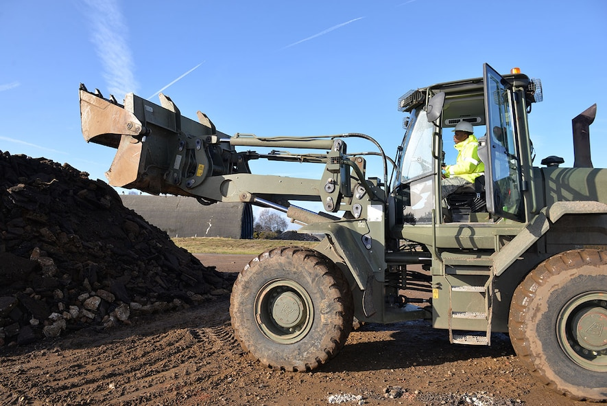U.S. Air Force Airman 1st Class Tyler Alfred, 100th Civil Engineer Squadron pavements and equipment apprentice, operates a British Army front end loader, as he empties broken concrete onto a stockpile at Rock Barracks, Woodbridge, England, Jan. 25, 2018. U.S. Air Force Airmen from the 100th Civil Engineer Squadron pavements and equipment flight spent a week working alongside British Army engineers from the 23 Parachute Engineer Regiment, training their NATO partners in airfield damage repair. The Airmen and soldiers each had the opportunity to use each other's heavy equipment and working practices. (U.S. Air Force photo by Karen Abeyasekere)