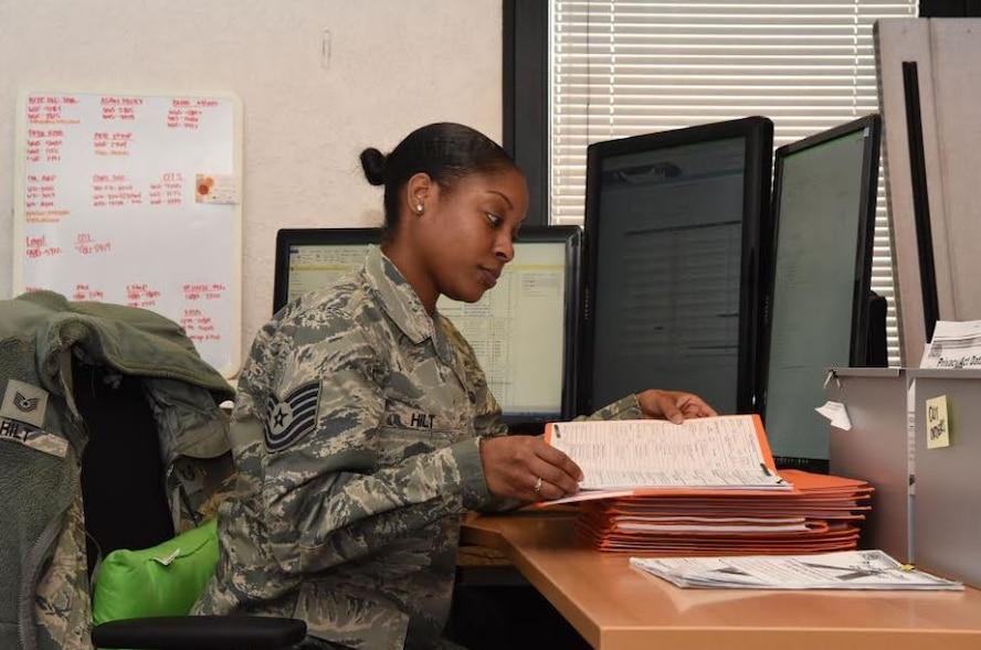 Tech. Sgt. Hilt, 786 Force Support Squadron noncommissioned officer in charge of Base Relocations, reviews records of Airmen in the Base Relocations Office Jan. 31, 2018 on Ramstein Air Base. The Air Force Personnel Center is ready for any unanticipated situations users may be experiencing and they encourage feedback throughout the introduction of this new process.